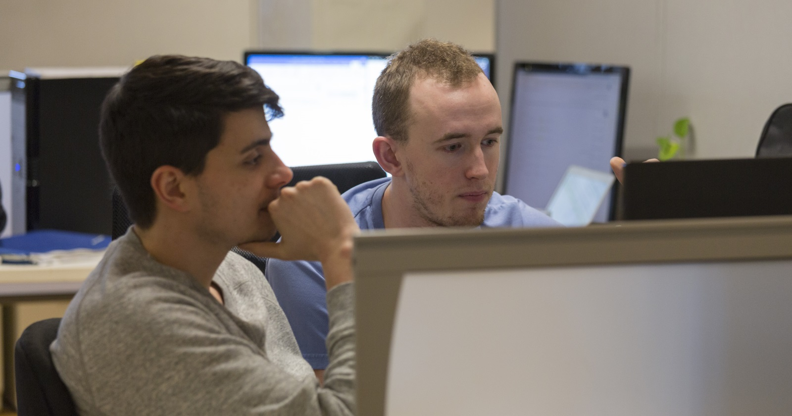 Two employees pair programming