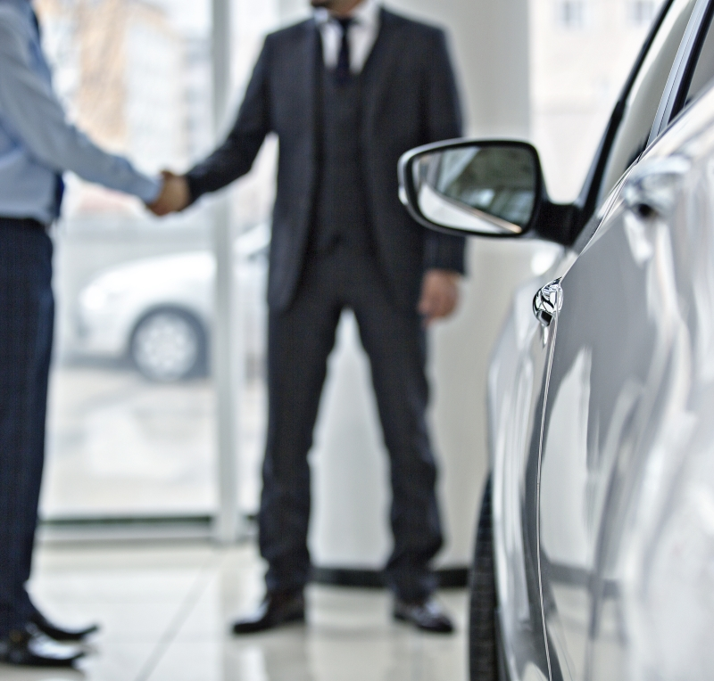 Shaking hands at auto dealership