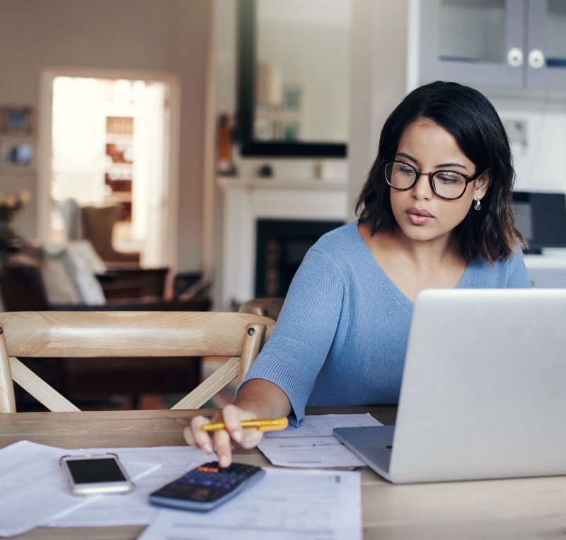 Woman doing personal taxes at home